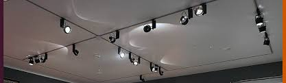 british lighting designers. museum gallery lighting for textile exhibition conservation 50 lux as specified by the british designers