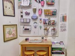 diy kids art studio space with pegboard