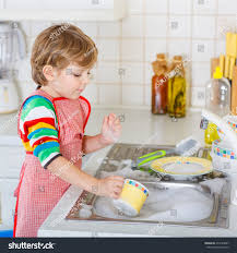 boys washing dishes.  Boys Funny Blond Kid Boy Washing Dishes In Domestic Kitchen Child Having Fun  With Helping His Intended Boys Washing Dishes