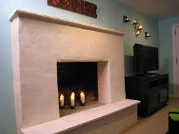 weekend projects resurface a fireplace with stucco within tile over brick fireplace