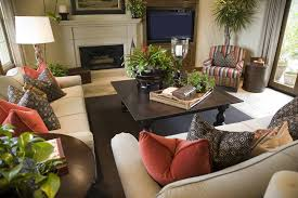 green living room chair. large living room with plants and red, blue brown color scheme furnished two green chair