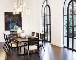 interesting tube covered modern dining room light fixture which is placed across abstract painting in the wall also above black simple dining table best lighting for dining room