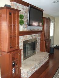custom made mantel crown molding stone fireplace surround and cabinets
