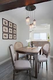 edison light fixtures dining room traditional with baseboard blue and white cascading lights driftwood