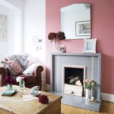 Bright living room with colourful chimney breast