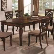 In contrast with the prior entry, this traditionally styled wood table  features carved legs and