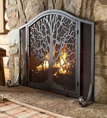 marvellous ideas wood fireplace screens 9 tree of life fire screen with door the symbolizes the