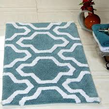bathroom calming blue color with white patterned soft cotton bathroom rug sets next to vase