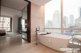 nyc bathroom law. the west side suite includes spacious bathrooms with a separate soaking tub placed to overlook nyc bathroom law