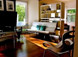 great mid century modern living room chairs design featuring glass coffee table and free standing bookshelf also wooden flooring