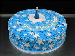 Frozen Elsa On Buttercream Swirls And Snow Flakes Cake