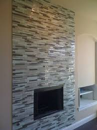 grey glass mosaic tile fireplace surround maybe a ribbon that goes all the way up