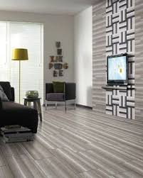 turin taupe ceramic tile is a perfect blend of warm taupe tones in a hardwood look pattern these tiles are durable and easy to clean making them perfect
