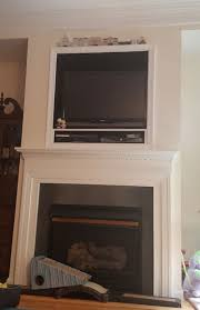 the easy way out of this is to just create a wood frame over the mouth of the niche and mount a larger flatscreen on that