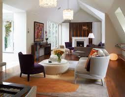 Orange Rugs For Living Room Living Rooms Sloped Ceiling White Fireplace Wood Flooring Floor