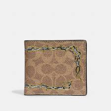 COACH Official Site Official page DOUBLE BILLFOLD WALLET IN SIGNATURE  CANVAS WITH TATTOO