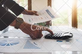 Analyst Concepts An Auditor Using A Calculator With A Budget
