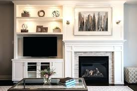 fireplace wall unit a built in shelving unit creates balance with an off center fireplace but