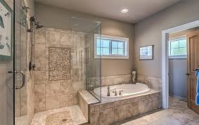 beige tile floor for large bathroom ideas with small tub and glass shower doors and beige wall color