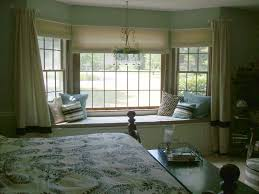 Remarkable Brown Bedroom Bay Window Design Idea with Cream Curtains and  Blue White Black Throw Pillows
