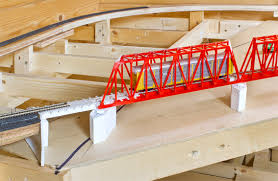 dcc nigel s mountains and modelling mrl bridge 218 has progressed a little recently five piers two end abutments and the approach spans have been completed in a bid to span a large gap at