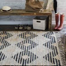 mudroom with wooden bench and jute rug natural beauty rugs