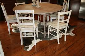 rug in kitchen under table. the skinny on decorating with cowhide rugs rug in kitchen under table