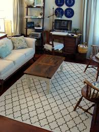 decor white quartefoil x rug with sofa and antique chairs for