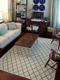 white quartefoil 8x10 rug with sofa and antique