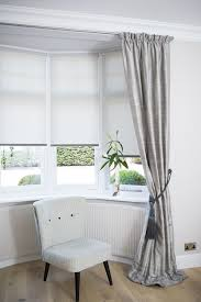 dressing a bay window by combining curtains and roller blinds creating simple elegance drapes n56