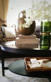 i ve been wanting an oval coffee table for some time and when i came across the malmsta table at ikea i was super happy because i knew it was going to