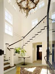 farmhouse foyer entry with antler chandelier flower plant paintings