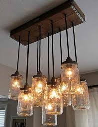 How to Make a Mason Jar Chandelier | Mason jar chandelier, Jar chandelier  and Diy light