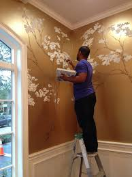 -hand painted cherry blossoms on metallic gold wall.