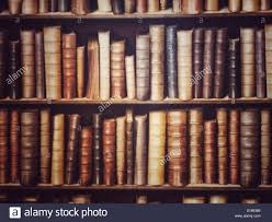 shelves full of dusty old and antique books in a dark library