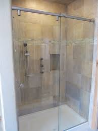 hydroslide frameless sliding shower enclosure with chrome finish and clear glass the beautifully tiled shower