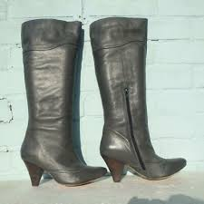 very warm and lovely lace up boots with faux fur lining made from real leather condition 4 out of 5 good vintage the sneakers are