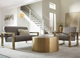 sofa and chair with gold accents