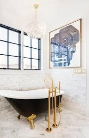 black vintage tub with gold claw feet