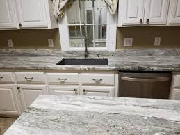 e a granite and marble countertops