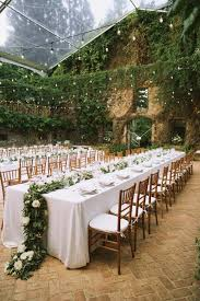 outdoor wedding venues. Bright sunny skies tropical flowers outdoor string lights make