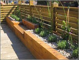 raised garden beds along fence small
