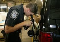 cbp officer inspects fuel tank of a vehicle cbp officer job description