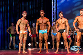 Juan Smith of South Africa (blue trunks) blowing away his competition :  bodybuilding
