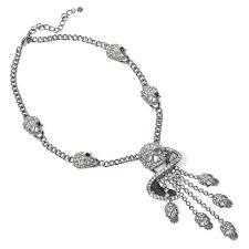 butler wilson crystal skull swirl and chain tassel with four side skull pendant pewter