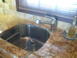 shaped kitchen sink faucet for d with franke you can also get a grid for the ledge that is halfway up ours