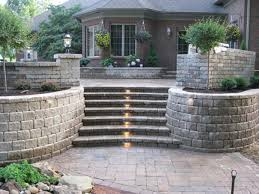 awesome stoned flower bed retaining walls are flanking steps with dim recessed lighting decor bed lighting fabulous
