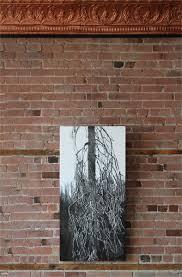 how to hang art on brick walls as hanging
