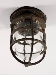 antique cast bronze cage light fixture with original glass signed oceanic nc1029 for