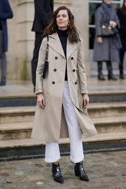 keeping up with the parisian classic style statement a lot of ankle boots were seen with long coats and faded denim bold crimson lips and berets were the